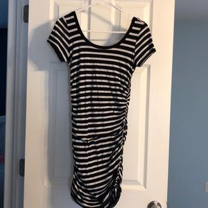 Black and white stripped side cinched dress.